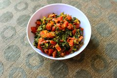 Cooked fenugreek and carrots Royalty Free Stock Photos