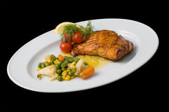 Cooked fish. On white plate stock photography