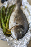 Cooked fish dorada with green asparagus Royalty Free Stock Photos