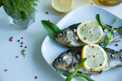 Cooked fish with lemon Stock Photo