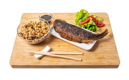 Cooked fish with rice and vegetables royalty free stock photos