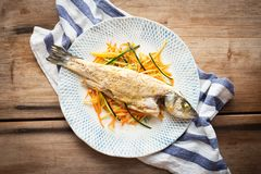Cooked fish with vegetables Stock Photo