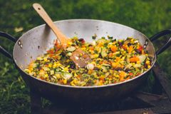 Cooked Food in Black Metal Cooking Pot Stock Photo