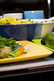 Cooked food on yellow platter Stock Photography