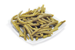 Cooked french beans. A plate of cooked french beans a white background Stock Photography