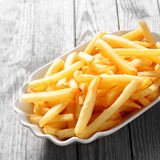 Cooked French Fries on White Plate on the Table Royalty Free Stock Image