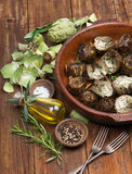 Cooked and fresh artichokes Royalty Free Stock Photo