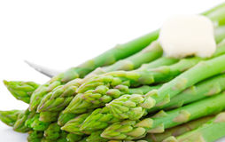 Cooked Asparagus With Butter. Cooked fresh asparagus with a pat of melting butter Royalty Free Stock Photography