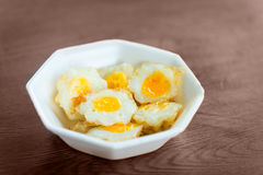 Cooked fried quail eggs Stock Image