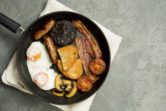 Cooked Full English Breakfast in Frying Pan Royalty Free Stock Images
