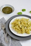 Cooked fusilli pasta on a plate with pesto. Italy food, healthy concept, vegetarian royalty free stock photo