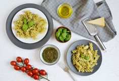 Cooked fusilli pasta on a plate with pesto. Italy food, healthy concept, vegetarian stock image