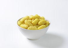 Cooked gnocchi. Bowl of cooked gnocchi on white background royalty free stock images