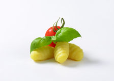 Cooked gnocchi. With cherry tomato and fresh basil on white background stock photo