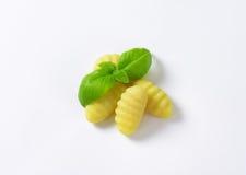 Cooked gnocchi. With fresh basil on white background royalty free stock photo