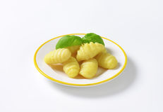 Cooked gnocchi. Plate of cooked gnocchi on white background stock image