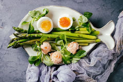 Cooked green asparagus with egg Stock Image