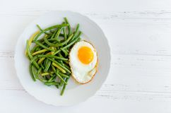 Cooked green beans with fried egg Royalty Free Stock Images