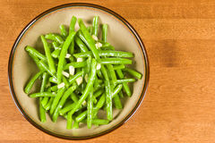 Cooked Green Beans and Garlic. A bowl of cooked green beans and garlic royalty free stock image