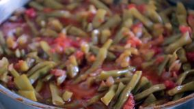 Cooked green beans stock video footage