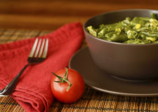 Cooked green beans and a tomato Royalty Free Stock Image