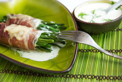 Cooked green beans. Wrapped in bacon, with cheese and cream fresh sauce Royalty Free Stock Photos