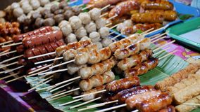 Cooked Grilled Sausages are sold in the Asian tray display. Traditional Thai food. The Jomtien night market. Pattaya stock video footage