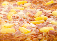 Cooked Hawaiian Pizza. Closeup of a cooked hawaiian pizza with pineapple and ham Stock Photos