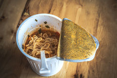 Cooked instant cup noodle with ingredient royalty free stock photo