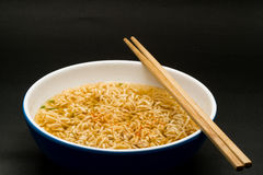 Cooked instant rice noodles in a bowl. On dark background Stock Photos