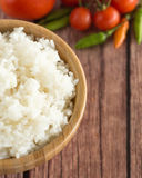 Cooked Jasmine rice in bowl on wooden background stock photos