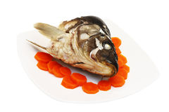 Cooked jowl and carrot. Cooked jowl from mirror carp and carrot royalty free stock photos