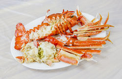 Cooked lobster on white dish. With plastic background Stock Photo