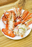 Cooked lobster on white dish. With wooden texture background Stock Images