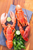 Cooked Lobsters on a Table with Lime and Parsley Stock Images