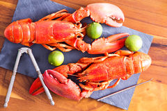 Cooked Lobsters on Table with Lime and Tool Royalty Free Stock Photography