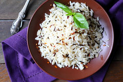 Cooked long grain rice in a ceramic plate Stock Photography