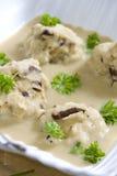 Cooked meal. Mushroom dumplings in egg-plan cream Stock Photo