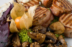 Cooked meat. On white plate stock image