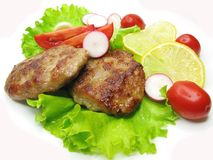 Cooked meat cutlets with vegetables Royalty Free Stock Photos