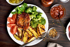 Cooked meat with vegetables on plate royalty free stock image