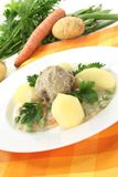 Cooked meatballs in a white sauce with capers Stock Photography