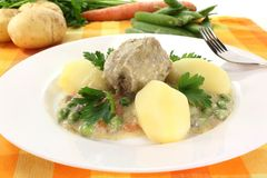 Cooked meatballs in a white sauce with capers Royalty Free Stock Photo