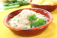 Cooked meatballs in a white sauce with capers Stock Images