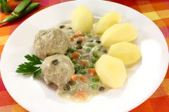 Cooked meatballs in a white sauce with capers Stock Photos