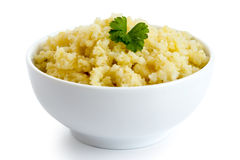 Cooked millet with green parsley in white ceramic bowl isolated Stock Photos