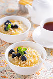 Cooked millet porridge with lemon curd and blueberry Stock Photos