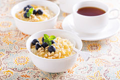 Cooked millet porridge with lemon curd and blueberry Stock Photography
