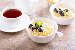 Cooked millet porridge with lemon curd and blueberry Stock Photo