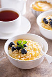 Cooked millet porridge with lemon curd and blueberry Royalty Free Stock Image